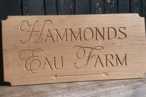 Hammond's Farm wooden sign with two fonts