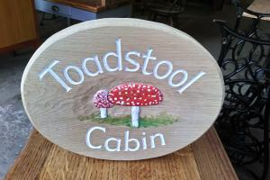 Wooden sign - toadstool cottage