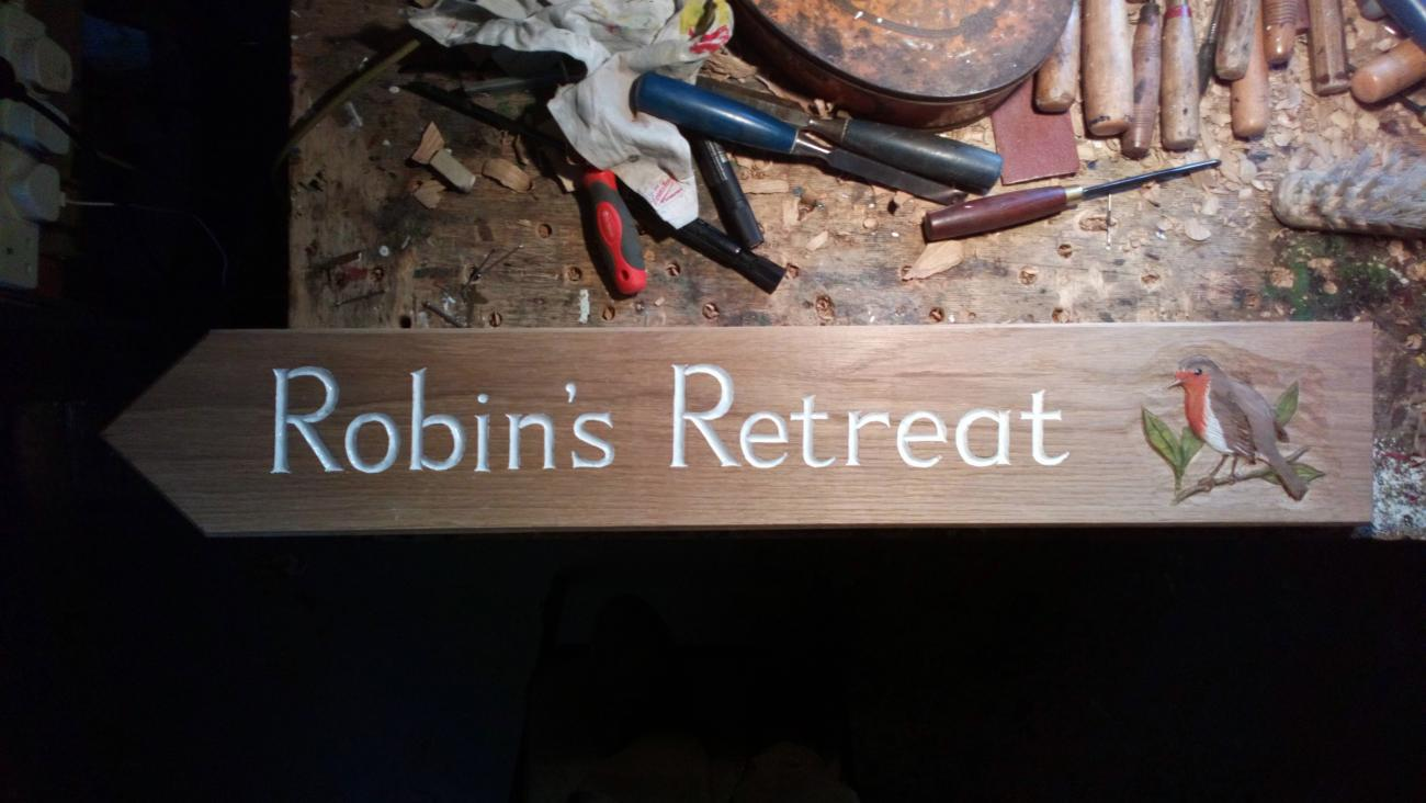 Robin's Retreat - wooden sign
