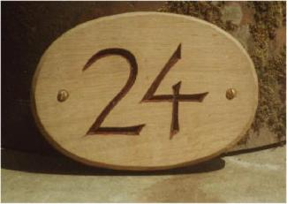 A Twenty Four Handmade Wooden Sign